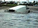 Idiot causes his van to sink in very dumb stunt.