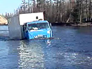 Insane truckdriver crosses heavy flooded streets