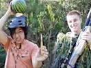 Watermelon shot off head with sniper rifle.