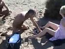 MILF gets swarmed by wanking zombies at nude beach.