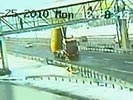Truck crashes into pedestrian bridge, killing a few.