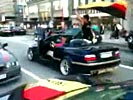 German soccer fan falls from convertible during celebration.