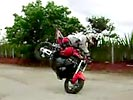 Amazing 180 degree endo on motorcycle.