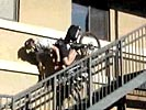 Security officer falls down stairs on a bike. A well deserved faceplant! :-P