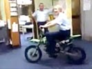 Police woman owned while riding motorcycle indoors.