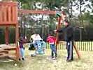 Dad owned by swingset at playground